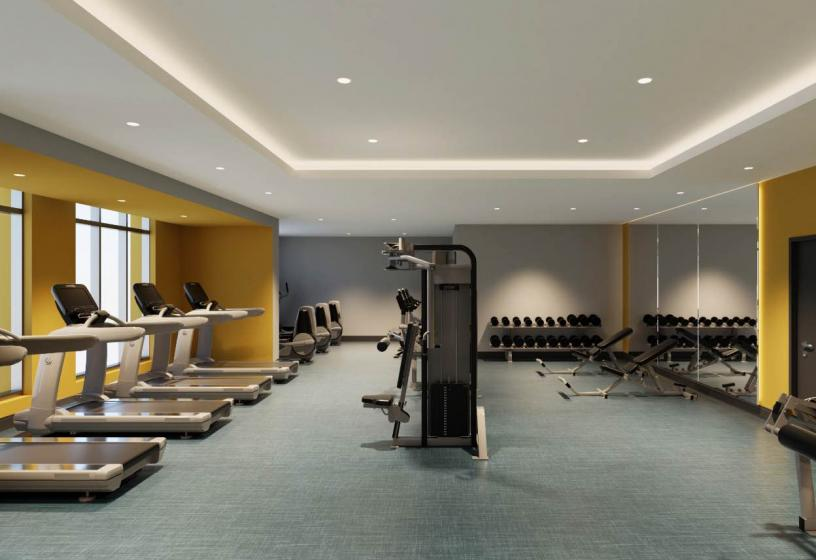 Onsite fitness room with cardio and weight training equipment.